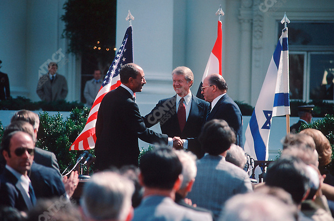 Israeli Prime Minister Menachem Begin, Egyptian President Anwar Sadar and US President Jimmy Carter, signing of the Israel-Egypt Peace Treaty, Washington DC, March 26, 1979