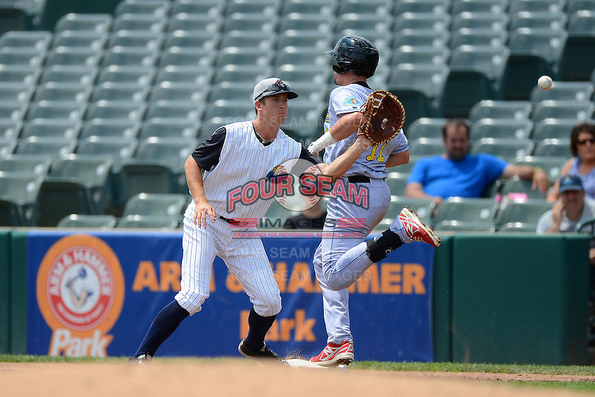 Trenton Thunder first baseman Casey Stevenson #31 waits for a throw as Derrick Mitchell #11 runs through the bag during a game against the Reading Fightin Phils on July 8, 2013 at Arm & Hammer Park in Trenton, New Jersey.  Trenton defeated Reading 10-6.  (Mike Janes/Four Seam Images)
