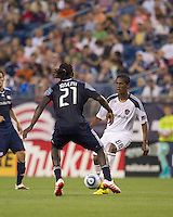 Los Angeles Galaxy defender Alex Cazumba (88) passes the ball as New England Revolution midfielder Shalrie Joseph (21) defends. The New England Revolution defeated LA Galaxy, 2-0, at Gillette Stadium on July 10, 2010.