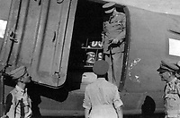 BNPS.co.uk (01202 558833)<br /> Pic: Pen&Sword/BNPS<br /> <br /> Bobby Kidd saying goodbye to Churchill with Field Marshal Alexander to the right, Loreto Aerodrome, 25 August 1944.<br /> <br /> Previously unseen photos of Winston Churchill both in the theatre of war and at leisure afterwards have come to light in a new book.<br /> <br /> One snap shows him addressing troops of his 4th Hussars regiment in Cairo, while he is seen in another at the door of an aircraft with a trademark cigar in his mouth. <br /> <br /> There is also a candid image of the wartime leader painting at Lake Como in September 1945 where he convalesced after losing to Clement Attlee in the general election.<br /> <br /> The photos belonged to Lieutenant Colonel Anthony Barne, who was commanding officer of the 4th Hussars.<br /> <br /> The photos, and Lt Col Barne's war diaries, are published for the first time in a new book, Churchill's Colonel, which has been edited by his grandson Charles Barne.