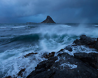 Stormy waves crash against coast with Bleikøya in the background, Bleik, Vesterålen, Norway