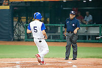 20 August 2007: #5 Kenji Hagiwara scores during the Czech Republic 6-1 victory over France in the Good Luck Beijing International baseball tournament (olympic test event) at the Wukesong Baseball Field in Beijing, China.