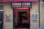 Restaurant entrance doorway Brick Lane, London, E1, England