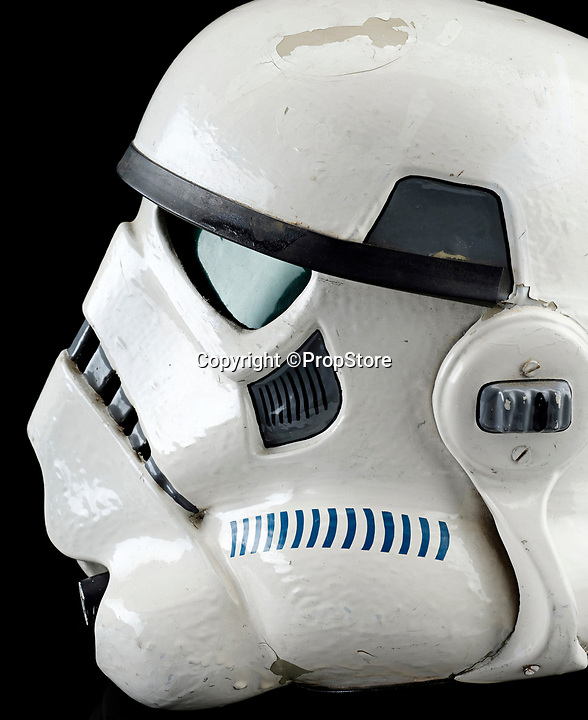 BNPS.co.uk (01202 558833)<br /> Pic: PropStore/BNPS.<br /> <br /> A Stormtrooper helmet from the first Star Wars film has sold for almost £200,000 by a relative of a British country squire.<br /> <br /> Captain Robert Hawkins and his wife Anne were gifted the iconic helmet for staging the Star Wars Cross Country Team Event at their English manor house in 1978.<br /> <br /> The bizarre equestrian event was attended by Carrie Fisher, who played Princess Leia, Darth Vader actor David Prowse, Peter Mayhew, who played Chewbacca, and football pundit Jimmy Hill.