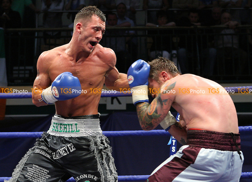 Grant Skehill (Wanstead, black shorts) defeats Duncan Cottier (Woodford, claret/blue shorts) in a Light-Middleweight contest at York Hall, Bethnal Green, promoted by Frank Warren/Sports Network - 14/06/08 - MANDATORY CREDIT: Gavin Ellis/TGSPHOTO. Self-Billing applies where appropriate. NO UNPAID USE. Tel: 0845 094 6026