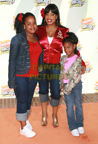 NIECY NASH & GUESTS.20th Annual Nickelodeon Kids' Choice Awards held at UCLA's Pauley Pavilion, Westwood, California, USA..March 31st, 2007.full length jeans denim rolled up turned jacket red flower in hair .CAP/ADM/CH.©Charles Harris/AdMedia/Capital Pictures