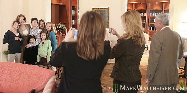 Former Florida Governor Bob Graham, right, watches as daughters Kendall Graham Elias, foreground left, and Suzanne Graham Gibson take photos of their mother, former first lady Adel Graham, center left, and her grandchildren in the Governor's Mansion where the Grahams raised their four daughters when they lived in Tallahassee  February 20, 2007.    (Mark Wallheiser/TallahasseeStock.com)