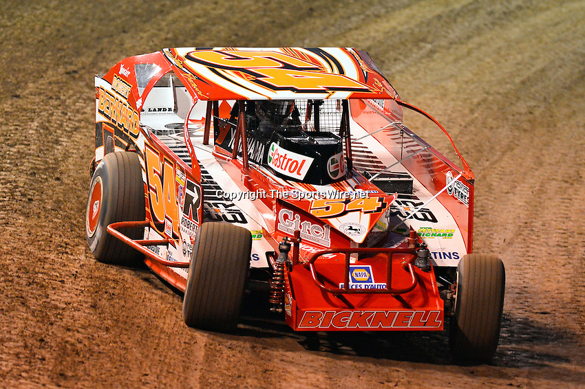 Feb 19, 2014; 6:41:19 PM;  Barberville, FL, USA;  Super DIRT car Series Big Block Modifieds presented by Summit Racing Equipment at Volusia Speedway Park.  Mandatory Credit: (thesportswire.net)
