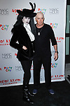 Desiree Gruber and Kyle MacLachlan arrive at Heidi Klum's 18th Annual Halloween Party presented by Party City and SVEDKA Vodka at Magic Hour Rooftop Bar & Lounge at Moxy Times Square, on October 31, 2017.