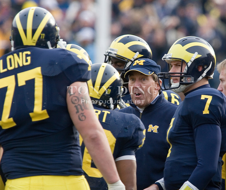 4 November 2006: Michigan head coach Lloyd Carr talks to his offense, including quarterback Chad Henne (7) and lineman Jake Long (77), during No. 2 Michigan's 34-26 win over MAC opponent Ball State at Michigan Stadium in Ann Arbor, MI. This was the two school's first meeting on the football field and Michigan's last home game of the season. The Wolverines go on the road at Indiana next week and finish in Columbus to face the No. 1 Ohio State Buckeyes.