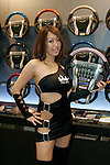 Jan 15, 2010 - Chiba, Japan - Campaign girl of Real company stand beside displayed steering wheels during the Tokyo Auto Salon 2010 in Chiba, suburb Tokyo, on January 15, 2010. More than 400 companies, associations and groups are displaying more than 600 custom vehicules in the Japan's biggest tuning show which takes place between January 15 and 17. (Photo Laurent Benchana/Nippon News)
