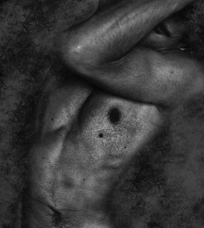 A naked male torso