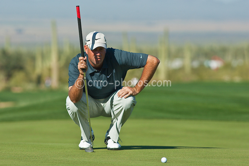 Feb 28, 2009; Marana, AZ, USA; Stewart Cink (USA) examines a putt on the 9th hole during the quarterfinal round of the World Golf Championships-Accenture Match Play Championship at the Ritz-Carlton Golf Club, Dove Mountain.