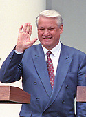 President Boris Yeltsin of the Russian Federation, waves to the press after he and United States President George H.W. Bush announced an arms control agreement that will eliminate all of Russia's most powerful SS-18 multiple warhead missiles, in the Rose Garden of the White House in Washington, D.C. on June 16, 1992.  After making their statements the presidents took questions from the media.<br /> Credit: Ron Sachs / CNP