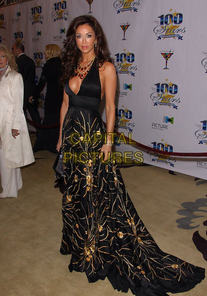 SOFIA MILOS .Night of 100 Stars - Arrivals held at the Beverly Hills Hotel, Beverly Hills, California, USA..March 7th, 2010.full length black gold maxi dress gown pattern .CAP/ADM/TC.©T. Conrad/AdMedia/Capital Pictures.