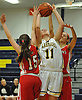 Angela Labenberg #11 of Wantagh, center, draws a shooting foul during a non-league varsity girls basketball game against St. John the Baptist at Baldwin High School on Monday, Dec. 26, 2016. Baptist won by a score 57-47.