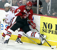 UNO's Matt Ambroz pins Wisconsin's Jake Gardiner behind the Wisconsin net during the second period. No. 16 UNO beat No. 7 Wisconsin 4-1 in front of a school-record crowd of 15,137 Friday night at Qwest Center Omaha.  (Photo by Michelle Bishop)