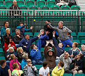 June 12th 2017,  Nottingham, England; WTA Aegon Nottingham Open Tennis Tournament day 3; The fans try to catch a ball hit into the stands by Croatian Qualifier Jana Fett as she beat German 7th seed Mona Barthel 6-3 5-7 7-5