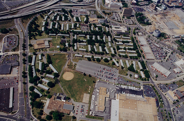 """1997 June 10.Aerial taken for David Smith.Tidewater Gardens (6-2 & 6-9).Assisted Housing..Tidewater Gardens looking Southeast.South Tidewater Drive on left.Church Street on right.Print from 35mm color neg..filed """"TIDEWATER1"""" AERIALS DRWPt1...NEG#.NRHA#..06/97  HOUSING:Tidewtr1  2:16  8.."""