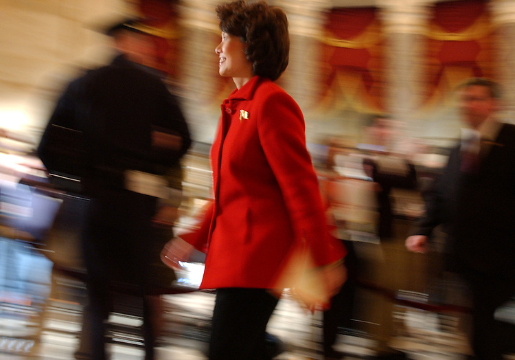 Secertary of Labor, Elaine Chao, makes her way through Statuary Hall before the State of the Union Address.