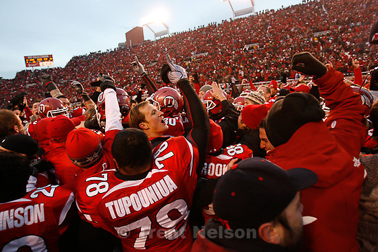Trent Nelson  |  The Salt Lake Tribune..Fans flood the field after the Utes beat BYU on a blocked field goal attempt at Rice-Eccles Stadium Saturday, November 27, 2010. The final score was Utah 17-BYU 16.