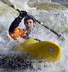 Kayaker Jeff Ledoux of Chicopee, surfs the rapids caused by rushing high water on the Connecticut River near the Dinosaur Footprints Reservation along Route 5 in Holyoke on Wednesday, April 6, 2005.