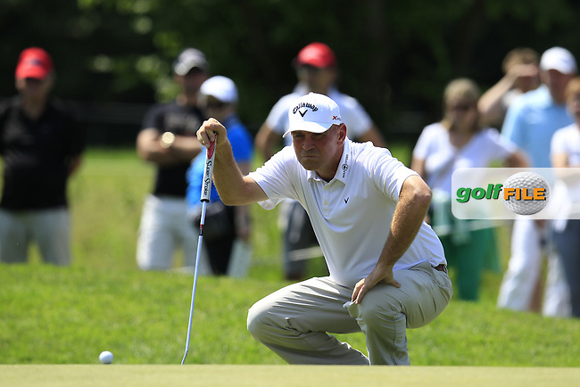 Thomas Bjorn (DEN) lines up his putt on the 8th green during Friday's Round 2 of the 2013 BMW International Open held on the Eichenried Golf Club, Munich, Germany. 21st June 2013<br /> (Picture: Eoin Clarke www.golffile.ie)