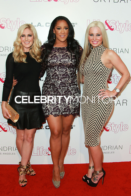 WEST HOLLYWOOD, CA, USA - OCTOBER 23: Heidi Montag, Natalie Nunn, Sarah Oliver arrive at the Life & Style Weekly 10 Year Anniversary Party held at SkyBar at the Mondrian Los Angeles on October 23, 2014 in West Hollywood, California, United States. (Photo by David Acosta/Celebrity Monitor)