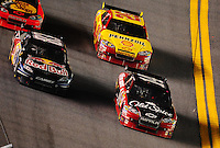 Feb 6, 2010; Daytona Beach, FL, USA; NASCAR Sprint Cup Series driver Tony Stewart (14) leads Brian Vickers (83) and Kevin Harvick (29) during the Bud Shootout at Daytona International Speedway. Mandatory Credit: Mark J. Rebilas-