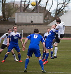 Second-half action from the Scottish pyramid play-off second leg between Edinburgh City (in white) and Cove Rangers at the Commonwealth Stadium at Meadowbank in Edinburgh. The match between the champions of the Lowland and Highland Leagues determined which club would play-off against East Stirlingshire for a place in the Scottish league. The second leg ended 1-1, giving Edinburgh City a 4-1 aggregate win.