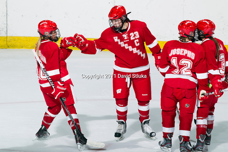 Wisconsin Badgers Hilary Knight (23) celebrates a goal with her teammates during an NCAA Women's College Hockey game against Lindenwood University Lions on September 23, 2011 in Madison, Wisconsin. The Badgers won 11-0. (Photo by David Stluka)