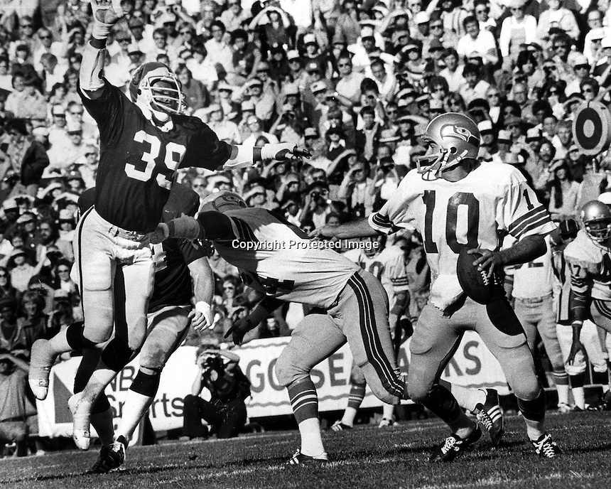 Oakland Raider linebacker Willie Hall puts rush on Seattle Seahawks QB <br />