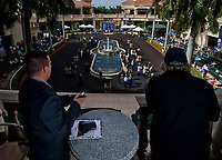 HALLANDALE BEACH, FL - JANUARY 27: Two spectators read the program while watching the paddock on Pegasus World Cup Invitational Day at Gulfstream Park Race Track on January 27, 2018 in Hallandale Beach, Florida. (Photo by Scott Serio/Eclipse Sportswire/Getty Images)