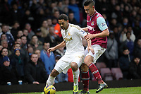 Barclays Premier League, West Ham United (red)V Swansea City Fc (white), Boelyn Ground, 02/02/13<br /> Pictured: Luke Moore came on as a substiture late in the second half Challenged by Winston Reid.<br /> Picture by: Ben Wyeth / Athena Picture Agency<br /> info@athena-pictures.com