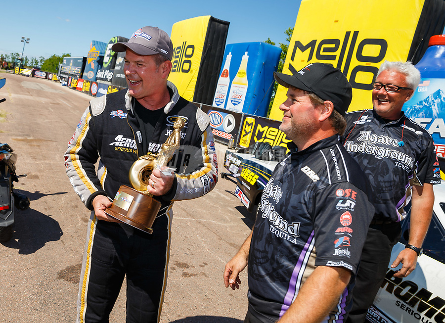 Apr 23, 2017; Baytown, TX, USA; NHRA pro mod drier Steve Matusek celebrates with crew members after winning the Springnationals at Royal Purple Raceway. Mandatory Credit: Mark J. Rebilas-USA TODAY Sports