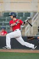 Grant Massey (16) of the Kannapolis Intimidators follows through on his swing against the Asheville Tourists at Kannapolis Intimidators Stadium on May 26, 2016 in Kannapolis, North Carolina.  The Tourists defeated the Intimidators 9-6 in 11 innings.  (Brian Westerholt/Four Seam Images)