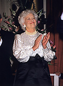 Barbara Bush attends a dinner at the Corcoran Gallery of Art in Washington, D.C. in honor of her husband, United States President-elect George H.W. Bush's Inauguration on January 18, 1989.<br /> Credit: Ron Sachs / Pool via CNP