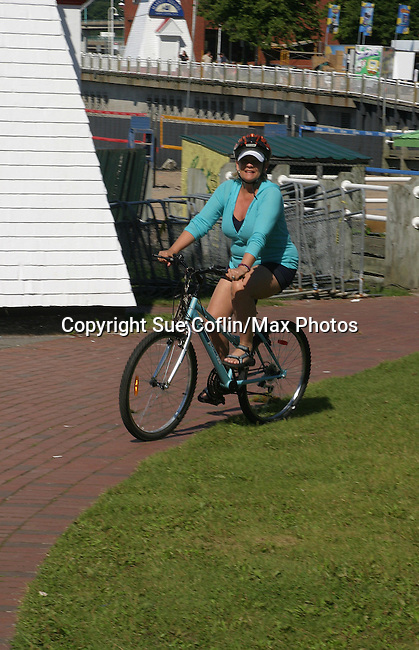 Kim Zimmer rides a bike in Saint John, New Brunswick - Day 2 - August 1, 2010 - So Long Springfield at Sea - A day in port in Saint John, New Brunswick, Canada from the Carnival's Glory (Photos by Sue Coflin/Max Photos)