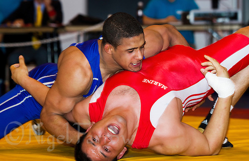 22 MAY 2010 - BIRMINGHAM, GBR - Saeed Hossaini (red) v Leon Rattigan (blue) - 2010 English Senior Wrestling Championships .(PHOTO (C) NIGEL FARROW)
