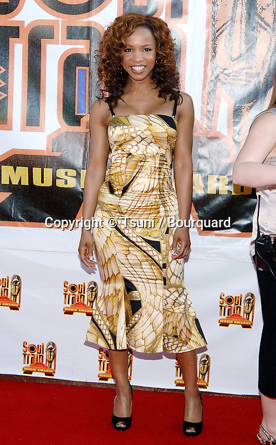 Elise Neal arriving at the SOUL TRAIN MUSIC Awards at the Pasadena Civic Auditorium in Los Angeles.<br /> <br /> full length<br /> smile<br /> eye contact<br /> printed dress