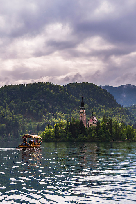 Pletna boat ride to Lake Bled Island and the Church of the Assumption of St Mary, Bled, Gorenjska, Slovenia, Europe