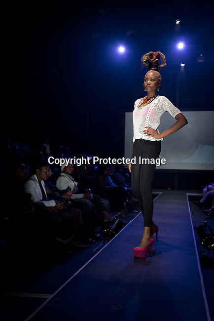SOWETO, SOUTH AFRICA MAY 31: Models for designer brand Woolaholics by Flora walks during a fashion show at Soweto Fashion Week on May 31, 2014 at the Soweto Theatre in the Jabulani section of Soweto, South Africa. Local emerging designers showed their collections during the three-day event held at the theatre. Founded in 2012, Soweto fashion week gives a platform to local designers, models and artists. (Photo by: Per-Anders Pettersson)