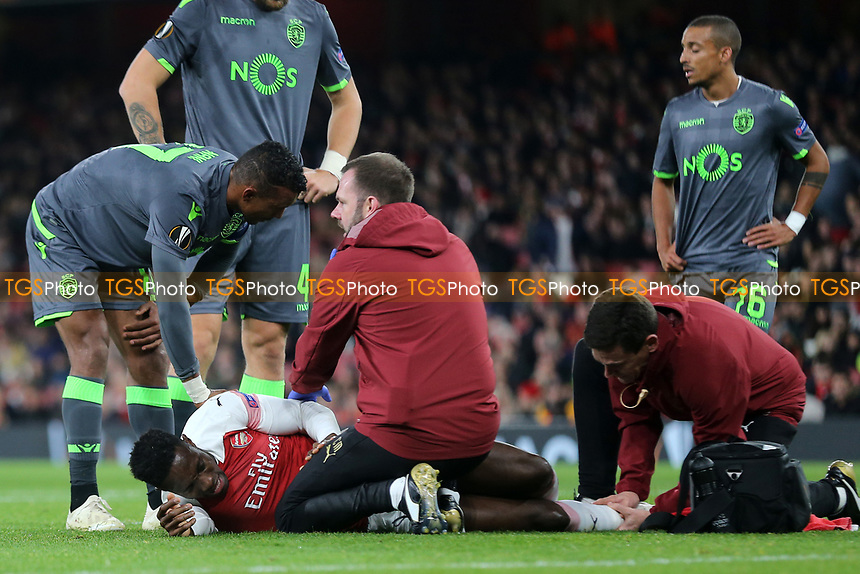 Nani of Sporting Lisbon consoles Arsenal's Danny Welbeck who receives treatment prior to being stretchered off with a serious injury during Arsenal vs Sporting Lisbon, UEFA Europa League Football at the Emirates Stadium on 8th November 2018