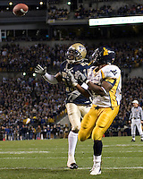 Pittsburgh Linebacker Tommie Campbell can't keep up with West Virginia Running Back Steve Slaton as Slaton gets ready to make an 11-yard touchdown catch. The WVU Mountaineers beat the Pitt Panthers 45-27 on November 16, 2006 at Heinz Field, Pittsburgh, Pennsylvania.