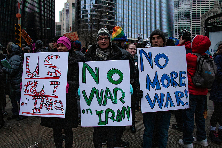 March through downtown Chicago demanding no war against Iran.