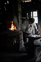 It is dark inside the blacksmith shop with the only light coming from the windows and the fire in the open hearth. Blacksmith Don Bailey has worked for Missouri Town 1855 for nine years. The Oak Grove man says he still enjoys his work. This old Missouri town is located on the east side of Lake Jacomo in Fleming Park in Blue Springs, MO. Missouri Town 1855 is a collection of original mid-19th century structures that were relocated from several Missouri counties to represent a typical 1850's farming community.