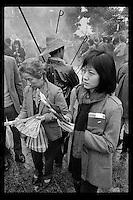 Hong Kong worshippers pray at Wong Tai Sin Taoist Temple in Kowloon, Hong Kong during the Lunar New Year, 1983.