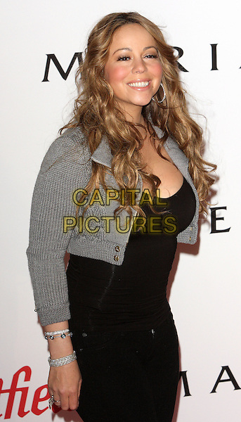 MARIAH CAREY.turns on the Christmas Lights at Westfield Shopping Centre, London, England, UK, November 19th 2009..half length black grey gray cropped silver hoop earrings smiling wavy hair  ring bracelets knitted jacket.CAP/ROS.©Steve Ross/Capital Pictures.