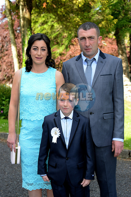 23/05/2015 – Termonfeckin Communion – Caélum Kearney Hoey and his parents Orla and Stephen.
