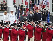United States President Donald J. Trump and first lady Melania Trump welcome President Emmanuel Macron and Mrs. Brigitte Macron of France for a state visit to The White House in Washington, DC, April 24, 2018. Credit: Chris Kleponis / Pool via CNP